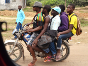 Daily life in Cameroon: Five men on a moped.